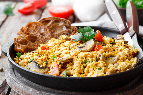 Veggie and egg scramble with toast.